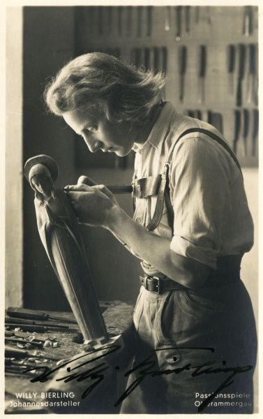 Willy Bierling, who plays the part of John the Baptist, working as a woodcarver. Date: 1934