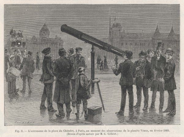 Astronomy at the Place du Chatelet in Paris. Street stargazers observe the planet Venus through a telescope