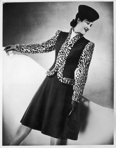 A woollen & fur costume from the Hershelle Model Collection with military pocket effect, full circle skirt & trimmings in ocelot peluche (imitation or fake fur)