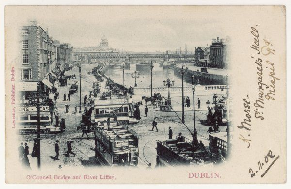 The O'Connell Bridge over the river Liffey - a busy scene with electric trams going every which way