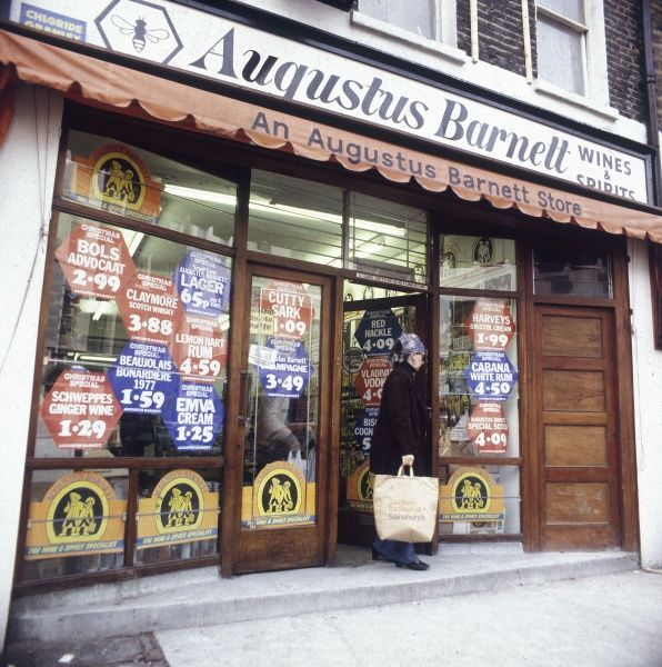 The shop window of an Augustus Barnett off-licence. Date: late 1970s