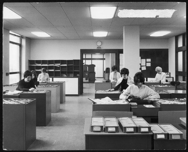 A group of female clerical workers in an office