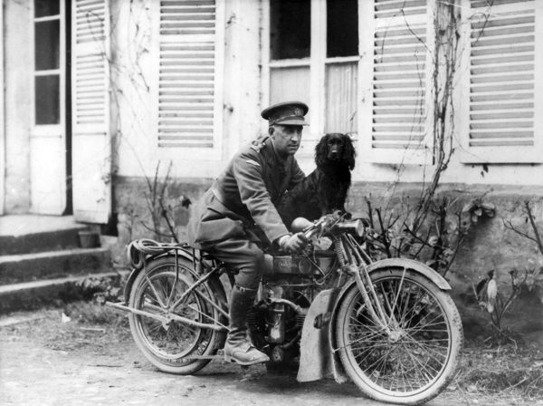 An officer of the Tank Corps on a Douglas motorbike with a spaniel dog, at Neulette, northern France, towards the end of the First World War. Date: 3 May 1918