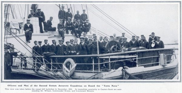 Officers and men of the Second British Antarctic Expedition on board the Terra Nova. The view was taken before the vessel left Lyttelton in December 1910. In immediate proximity to Captain Scott are seen standing Dr. Wilson, Commander Evans