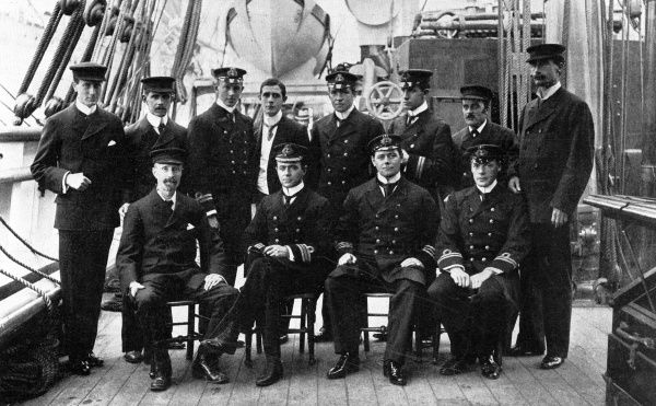 Photograph of the officers and scientists of the British Antarctic Expedition of 1901-04, on the deck of the research ship 'Discovery', 1901. The officers seated are (from left to right): Mr. G. Murray, FRS; Captain R.F. Scott; Lt. Armitage; Lt