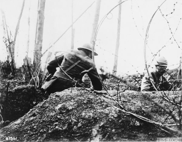 French and American officers cutting barbed wire near Badonviller during World War I