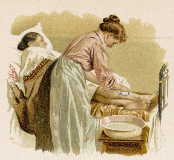 An elderly bedridden patient is given a bed bath