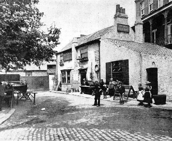 Photograph showing the Old Crab Tree Inn, Fulham, in London, 1898, which was due for demolition that year