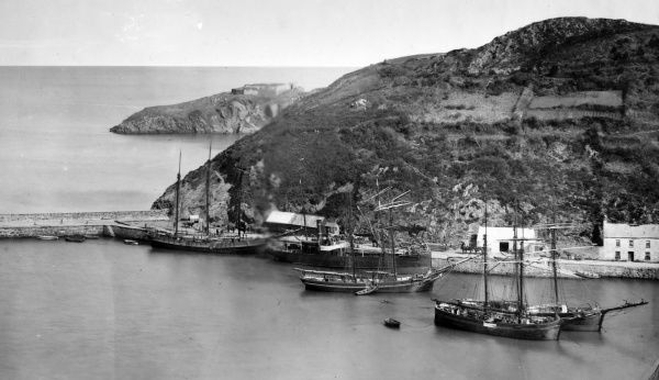 View of the Old Fishguard Harbour, with a steamer and sailing ships, in Pembrokeshire, South Wales, before the GWR railway station was built