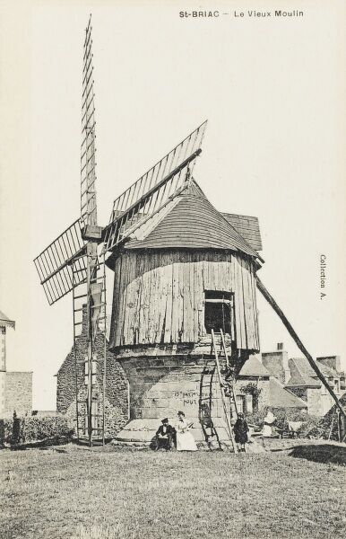 Old French wooden and stone Windmill (La Vieux Moulin) at St Briac, France