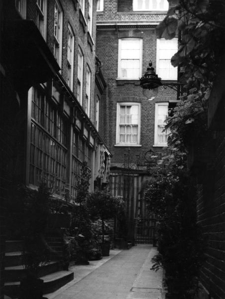 In a court off Bow Lane, at the side of Bow Church, Cheapside, London, is this building, reputed to be the original Old Mansion House. Date: 1950s