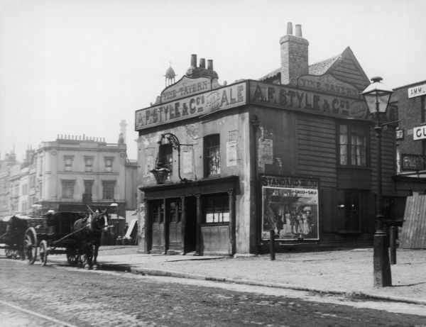 'The Old Vine Tavern' which literally stood 'in the road' at the junction of Mile End Road and Cambridge Heath Road, east London, was sadly demolished in the early 1900s