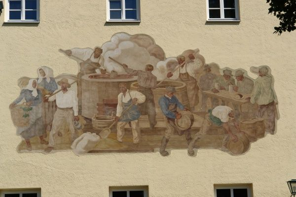Painting of a brewing scene on the exterior of the oldest brewery in the world, at Weihenstephan, near Freising, north of Munich, Bavaria, Germany. The brewery was established by Benedictine monks in 1040, and is still in operation today