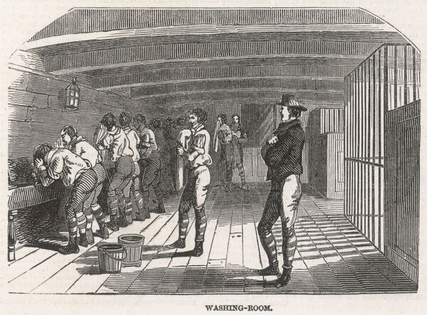 Prisoners wash at low basins while observed by officers, onboard the convict hulk ship, 'The Warrior'. The practice of confining offenders on board such ships was first adopted in England in 1776; it was popular in the 18th and 19th centuries