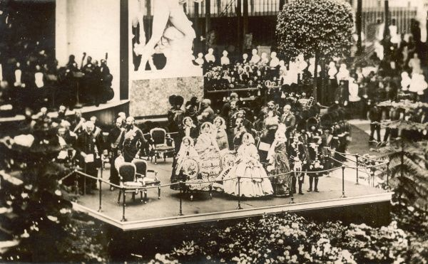 Photograph showing the opening ceremony of the Great Exhibition at Crystal Palace in 1851. To the front of the picture on the stand can be seen Queen Victoria and Prince Albert, surrounded by their children