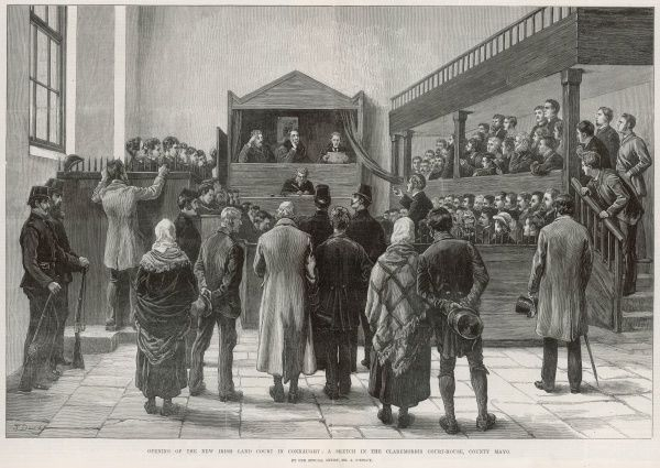 The opening of the Western Sub-Commission of the Land Court, for Connaught, at the town of Claremorris, in County Mayo, Ireland. The courthouse was crowded with local tenants interested to hear the approach to be taken by the Sub-Commission