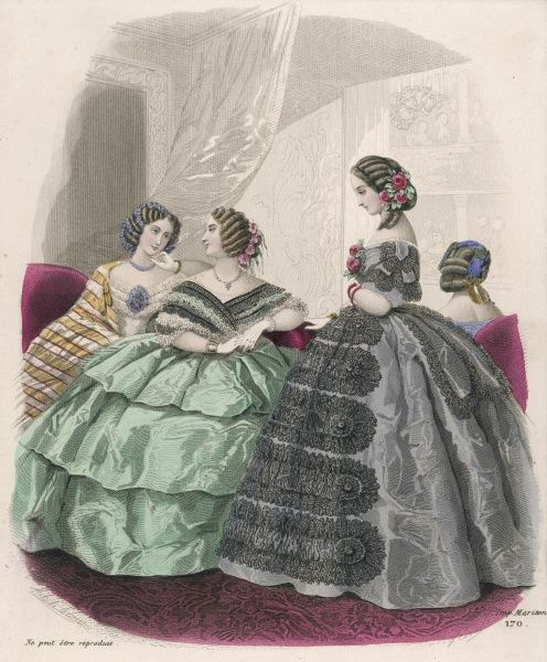 Green silk dress worn with a fichu Antoinette; grey dress with tablier of black lace; striped mantle / shawl. Hair arranged in stiff curls & chignons adorned with flowers