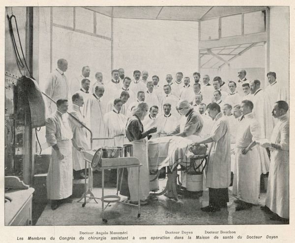 Eminent surgeon Dr Doyen performs an operation at the Maison de Sante, Paris, watched by students and colleagues