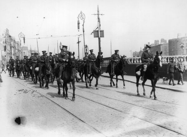 O.P.S Ulster Volunteers ride on horseback through the streets of Dublin during the Easter rising of April 1916