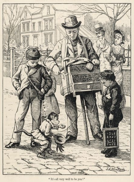 Schoolboys stop to admire the monkey who solicits a financial contribution to the upkeep of himself and his organ-grinding partner
