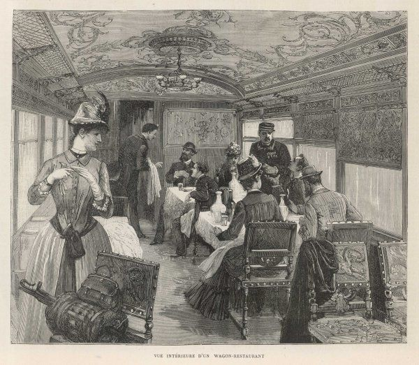 An interior view of passengers in the dining car