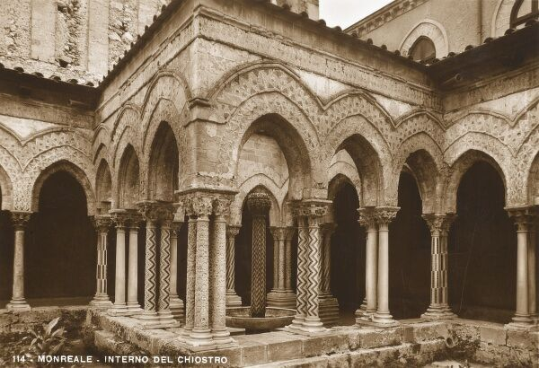 A fine example of cloister architecture with Gothic arches and thin patterned columns