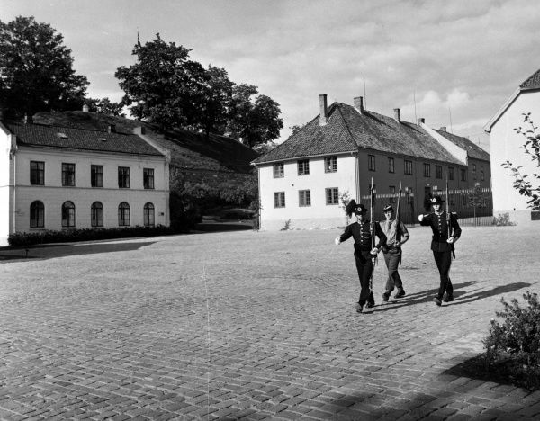 Three guards parading the grounds of Oslo Castle, Norway. Date: late 1960s