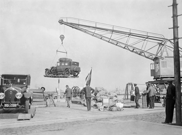 Unloading cars from the Ostend to Dover (England) cross channel ferry with a huge crane. Date: early 1930s