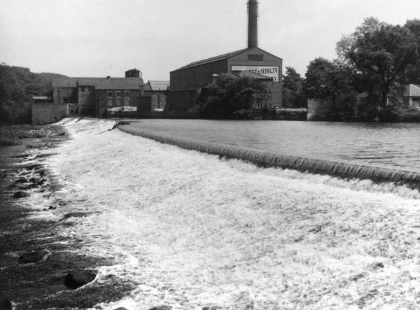 The weir on the River Wharfe at Otley. Yorkshire, England. Date: 1950s
