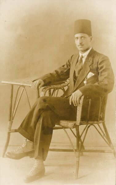 Photograph of a seated Ottoman gentleman with extremely fine shoes with white laces. Named on the reverse as Ahmed Ahmed El Arousi
