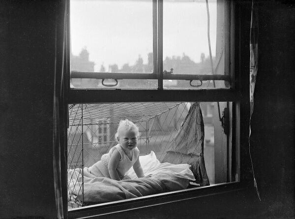 A handy baby cage, which can easily be fitted outside the window of even a modest flat. The baby can sleep soundly in the fresh air while the mother relaxes indoors... Date: 1930s