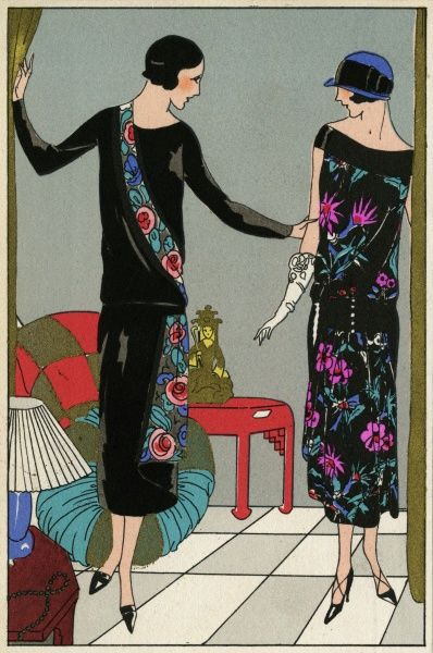 Two fashionable young ladies wearing the latest autumn outfits. On the left, a black crepe dress with floral detail, by Philippe et Gaston. On the right, a black velvet dress with floral design, by Redfern