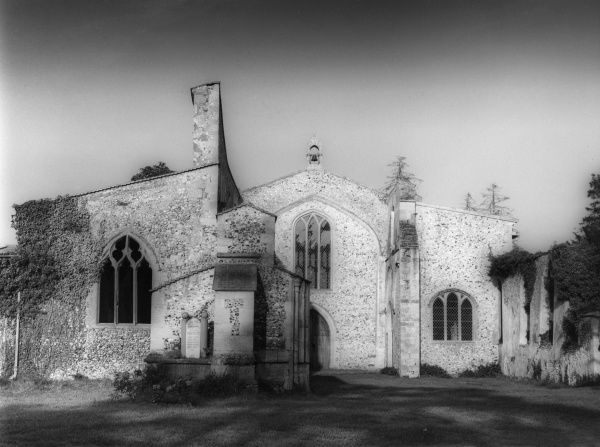 Exterior view of St. John's Church, Oxborough, Norfolk, England, infamous for the collapse of its tower in the autumn of 1948. Date: Medieval