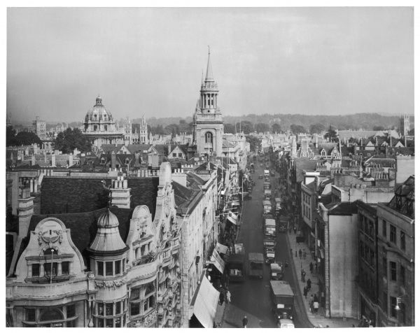 "Elevated view of Oxford High Street, showing the impressive facades, roof-tops and famous ""dreaming spires&quot"