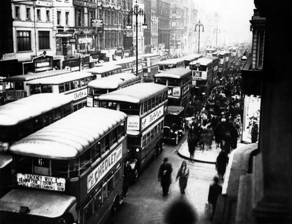 The street crammed with buses, near Oxford Circus. Date: 1930s
