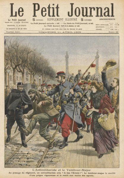 An anti-militarist agitator (depicted by this rightwing journal as a scruffy ruffian) is arrested by the police, to the approval of patriotic bystanders