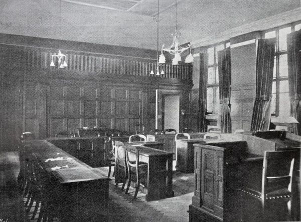 The wood-panelled Guardians' board-room in the new office building opened by the Paddington Poor Law Union in 1902 on Harrow Road. Date: 1902