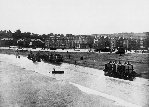 The sea front at Paignton, Devon, with bathing huts Date: 1895