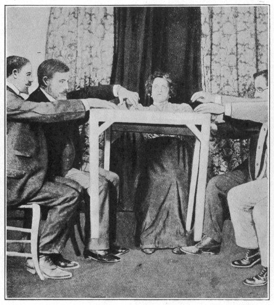 Eusapia causes a table to rise at Milano, 1892