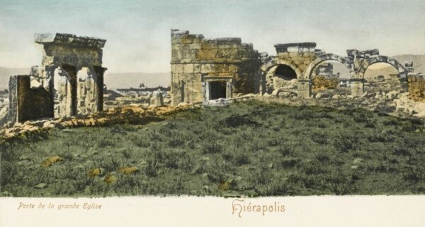 "Entrance to the Temple (ruins) at Hierapolis. Pamukkale, meaning ""cotton castle"" in Turkish, is a natural site and attraction in south-western Turkey in the Denizli Province. Pamukkale is located in Turkey's Inner Aegean region"