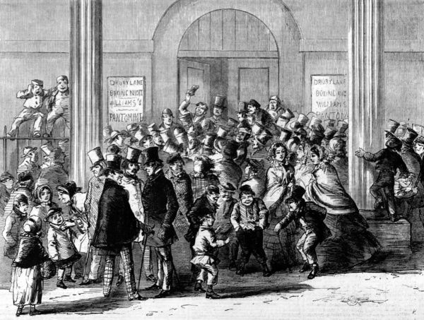 A crowd gathered outside Drury Lane Theatre waiting to attend a pantomime for Christmas