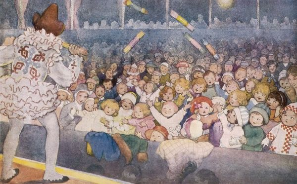 Lovely illustration by Susan Beatrice Pearse showing children at a Christmas pantomime. A clown on stage is throwing crackers into the audience stalls
