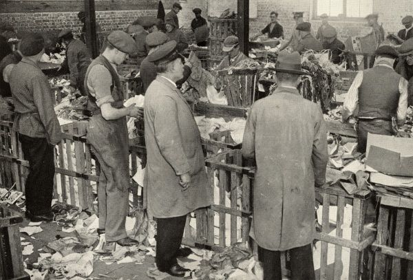 Men sorting paper at one of the Salvation Army Elevators. The Elevators provided the destitute with both short-term work and hostel-style accommodation