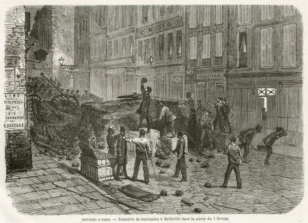 Rioters erect a barricade in the streets of Belleville, Paris