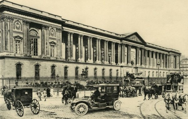 Motor cars and horse-drawn vehicles pass the Louvre. Date: circa 1904