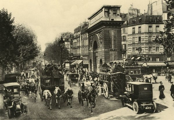 Traffic was as heavy on Les Grands Boulevards in 1904 as it is a century later : the Porte Saint-Martin marks the boundary of the old city. Date: circa 1904