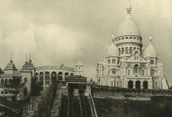 The church stands high on the butte de Montmartre, but you don't have to walk up the hill, there's a funicular to carry you for the price of a metro ticket. Date: circa 1904