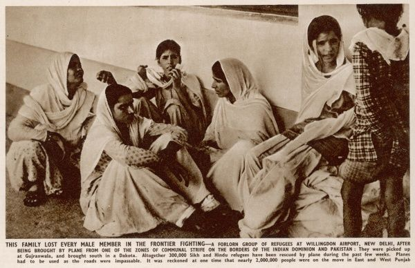 A family who lost every male member in the frontier fighting - a forlorn group of refugees at Willingdon airport, New Delhi, after being brought by plane from one of the zones of communal strife on the borders of India and Pakistan