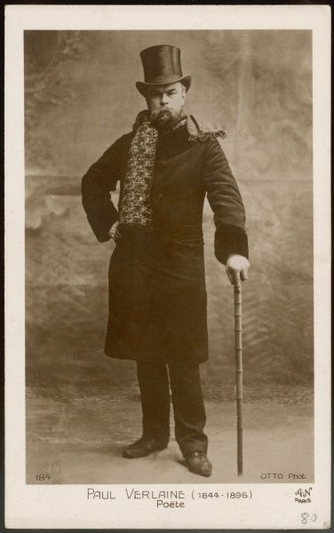 Paul Verlaine, French poet associated with the Symbolist movement. Seen here in a full-length photograph, wearing top hat, overcoat and scarf, and leaning on a walking stick