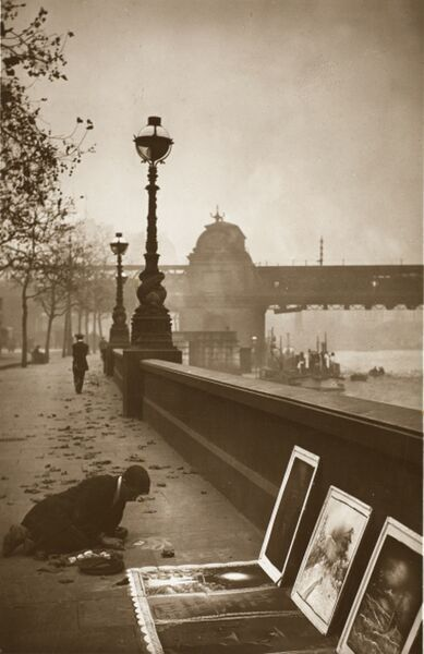 Pavement Artist - London Embankment - a variety of pictures are being worked on and other prints are being offered for sale